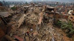 PHOTO: Rescue workers remove debris as they search for victims of earthquake in Bhaktapur near Kathmandu, Nepal, Sunday, April 26, 2015.