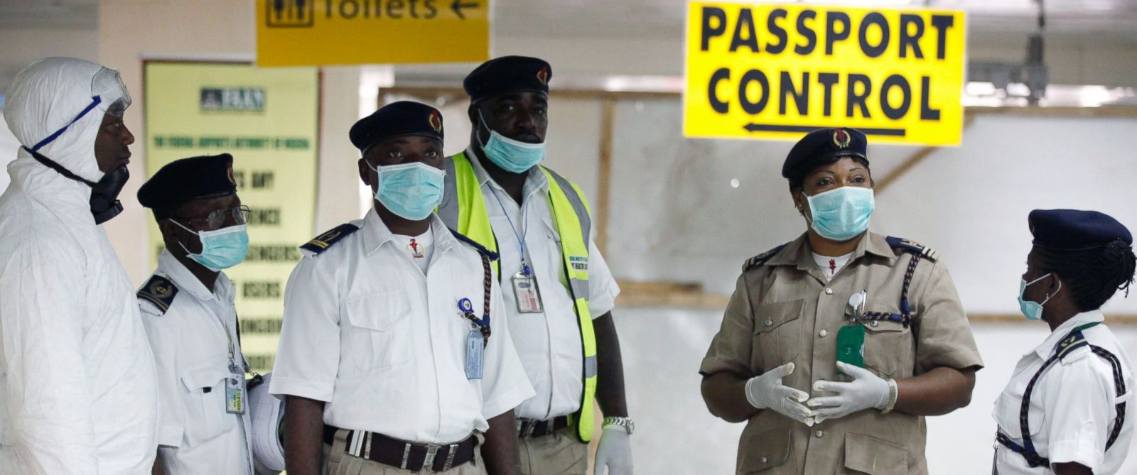PHOTO: Nigeria health officials wait to screen passengers at the arrival hall of Murtala Muhammed International Airport in Lagos, Nigeria, Aug. 4, 2014.