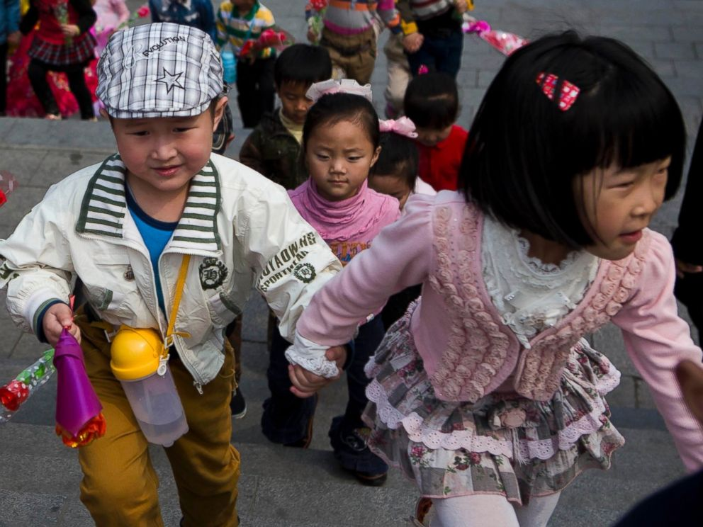 PHOTO: North Korean children climb steps near Mansu Hill on their way to lay flowers at the feet of bronze statues of the late North Korean leaders Kim Il Sung and Kim Jong Il in Pyongyang, North Korea on April 12, 2014.