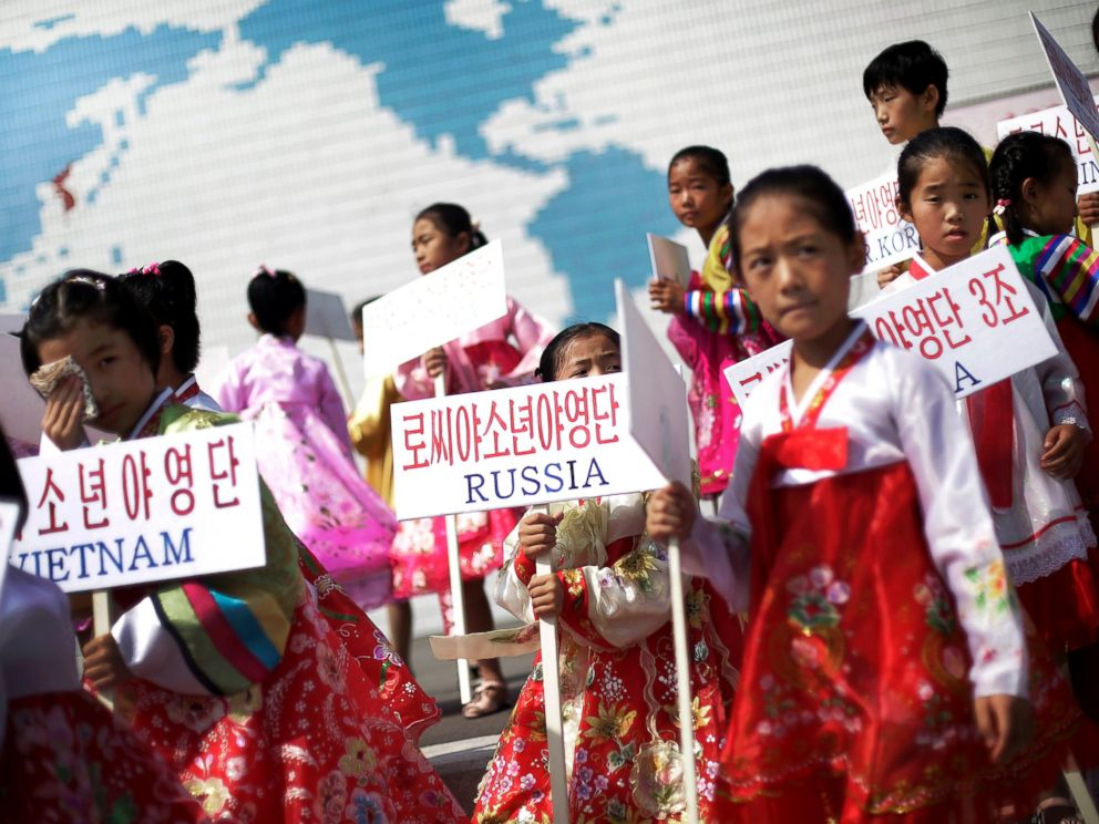 PHOTO: Young North Korean girls hold up signboards with the names of participating countries during an opening ceremony at the Songdowon International Childrens Camp, July 29, 2014, in Wonsan, North Korea.