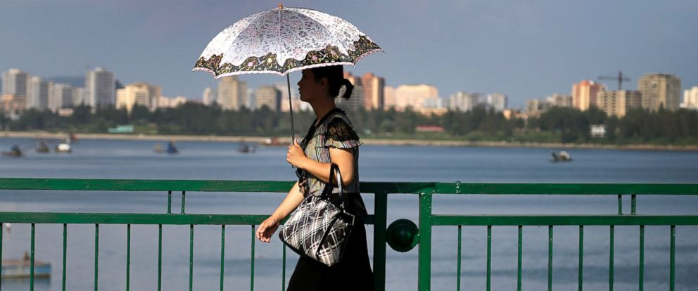 PHOTO: A North Korean woman walks along the Taedong River in Pyongyang, North Korea on Aug. 30, 2014.