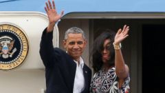 PHOTO: U.S. President Barack Obama and first lady Michelle Obama wave goodbye as they board Air Force One on its way to Argentina, in Havana, Cuba, March 22, 2016.