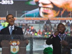 PHOTO: President Barack Obama delivers his speech next to a sign language interpreter