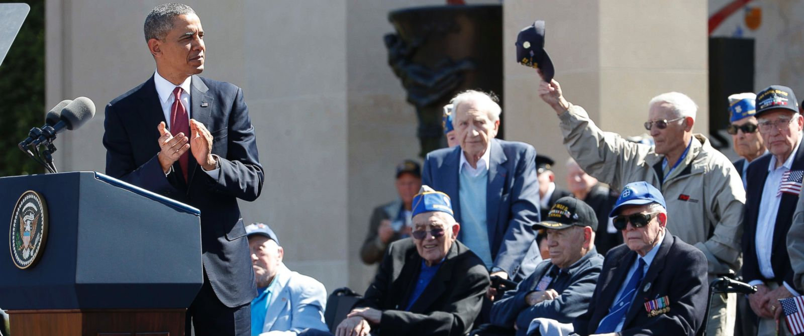 PHOTO: President Barack Obama acknowledges veterans as he speaks at Normandy American Cemetery at Omaha Beach as he participates in the 70th anniversary of D-Day in Colleville sur Mer in Normandy, France, June 6, 2014.