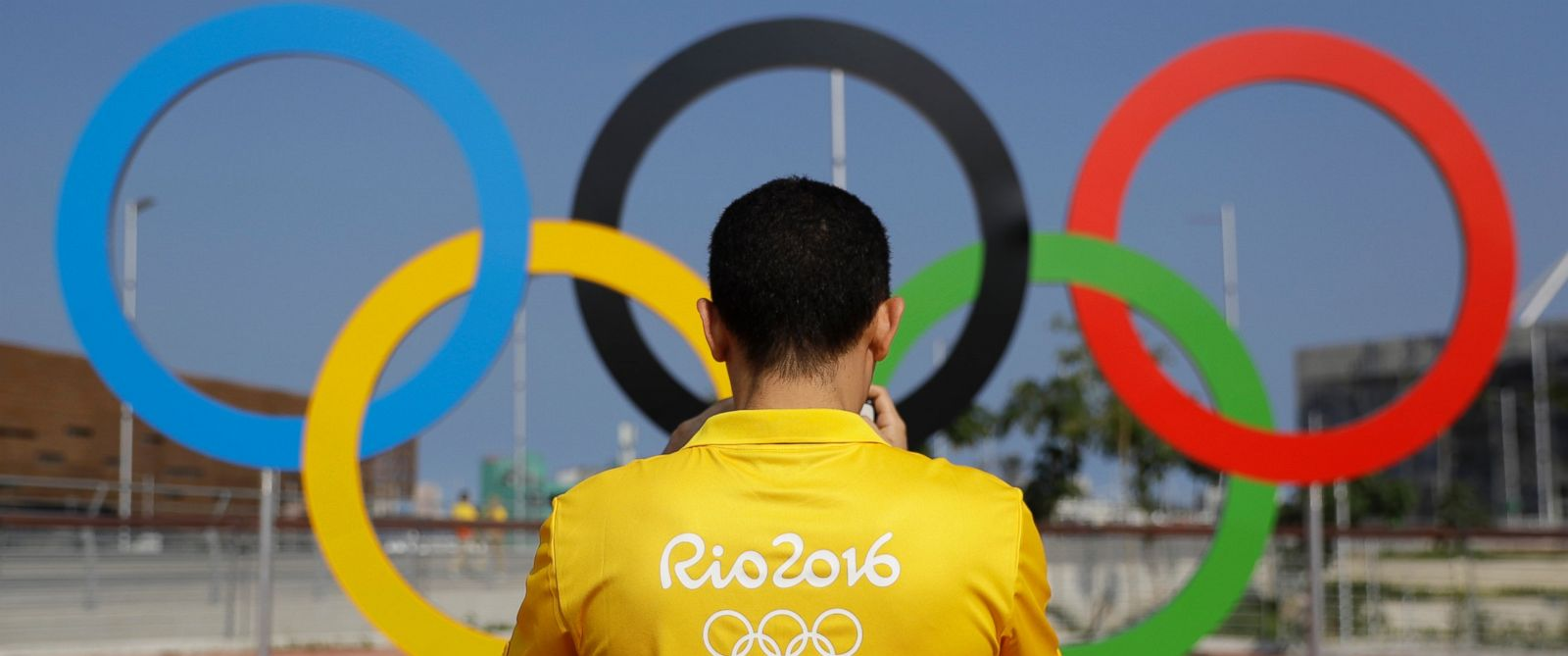 PHOTO: A volunteer photographs a set of Olympic Rings at Olympic Park in Rio de Janeiro, July 29, 2016.