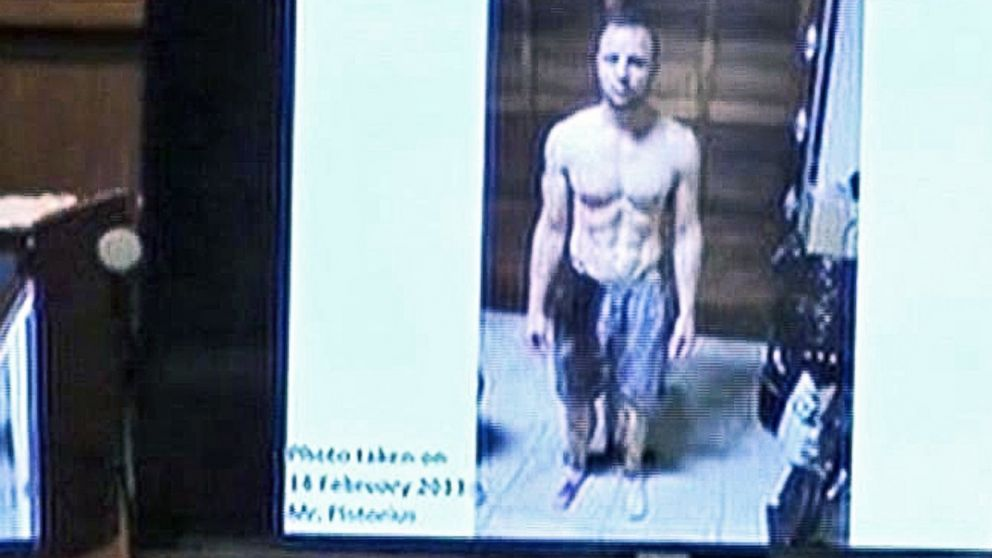 PHOTO: A police photograph of Oscar Pistorius standing on his blood-stained prosthetic legs was shown to the court at his mur