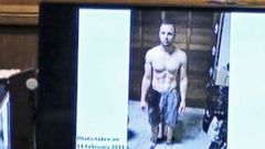 PHOTO: An image taken from the court pool TV via AP showing on screen a police photograph of Oscar Pistorius standing on his blood-stained prosthetic legs was shown to the court in Pretoria, at his murder trial, March 14, 2014.