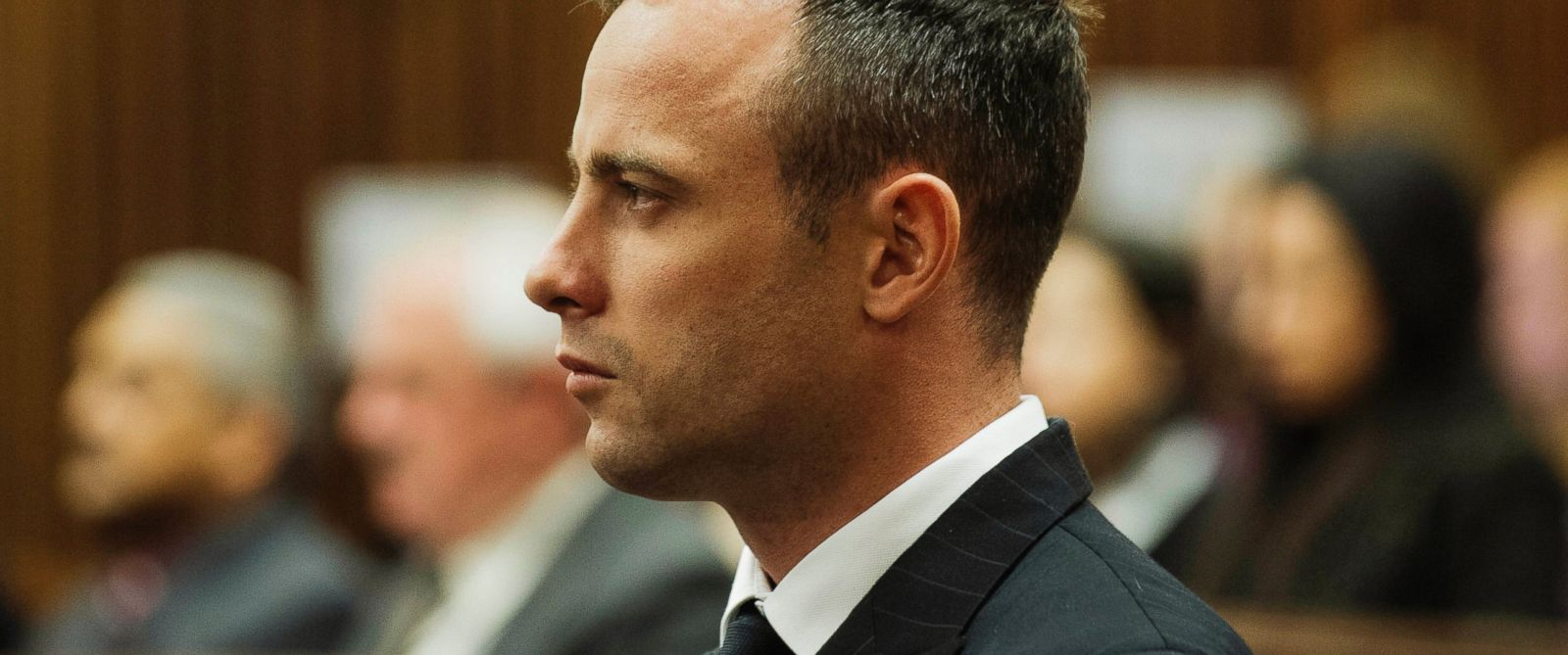 PHOTO: Oscar Pistorius listens to evidence being given in court, April 16, 2014, in Pretoria, South Africa.