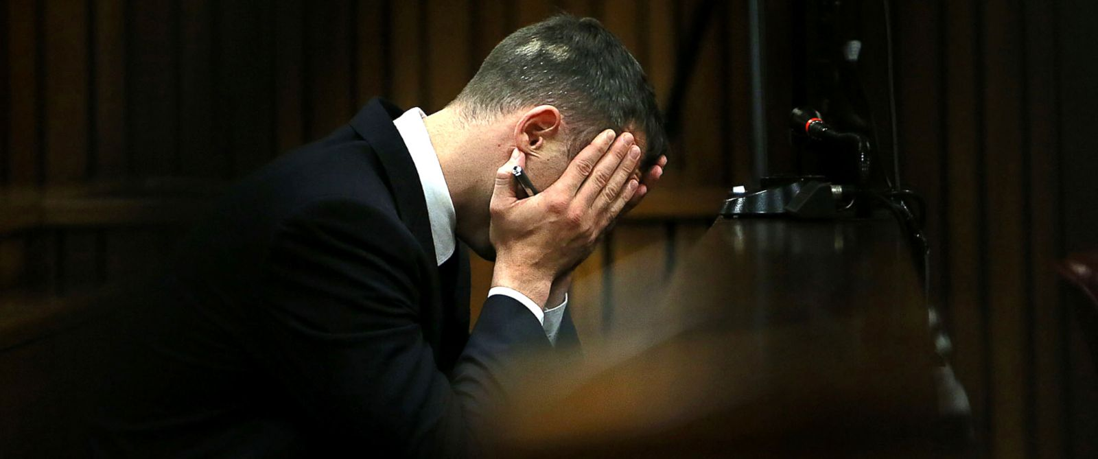 PHOTO: Oscar Pistorius holds his head in his hands as he listens to evidence being given in court in Pretoria, South Africa, April 15, 2014.