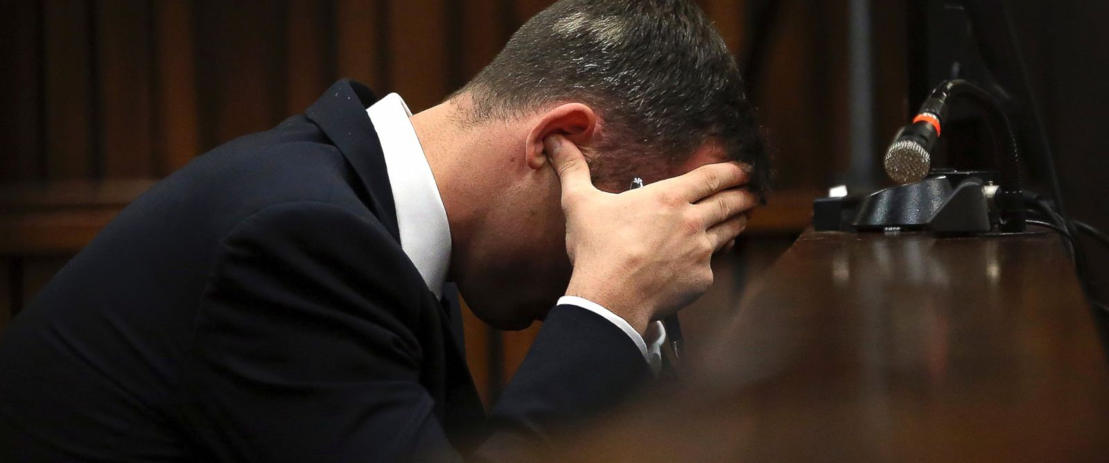 PHOTO: Oscar Pistorius, cradles his head in his hands as he listens to ballistic evidence being given in the court during his murder trial in Pretoria, South Africa, March 19, 2014.