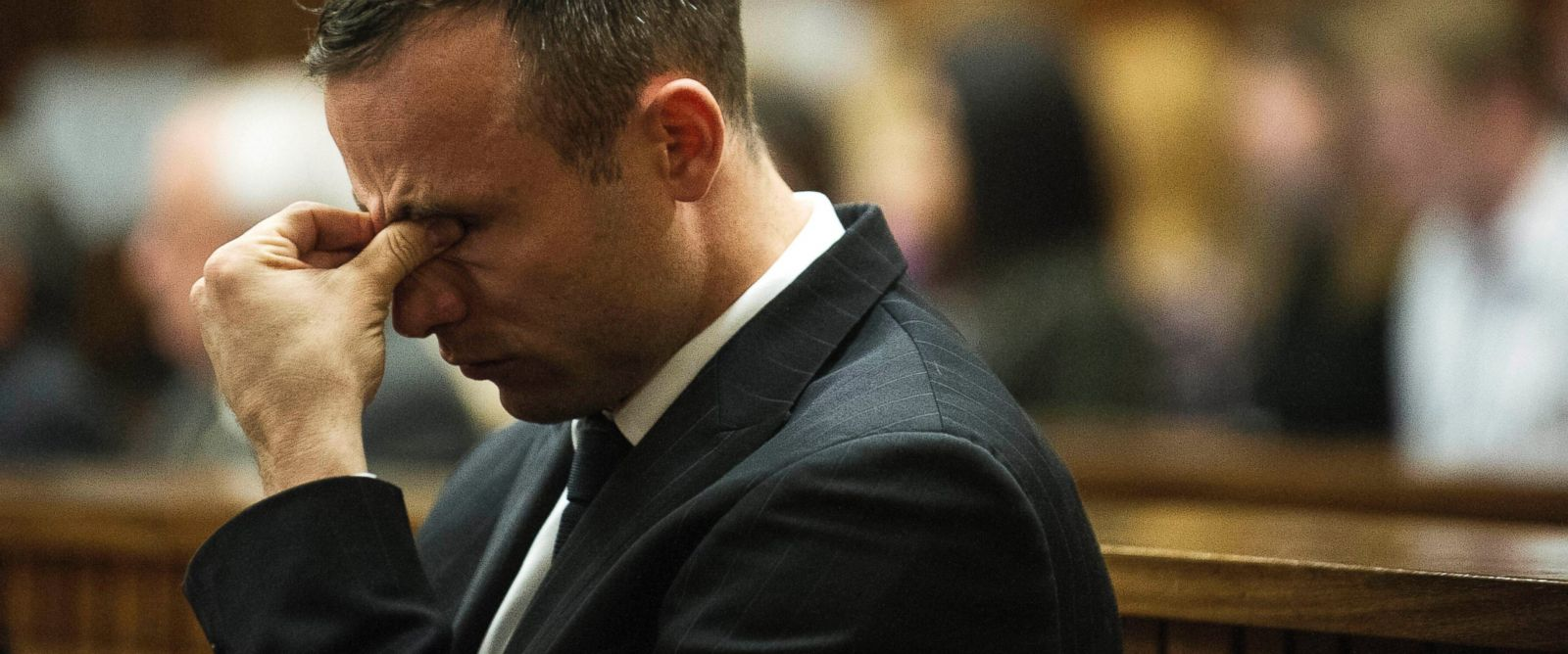 PHOTO: Oscar Pistorius reacts as he listens to forensic evidence being given in court in Pretoria, South Africa, April 16, 2014.