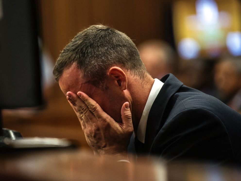 PHOTO: Oscar Pistorius cradles his head in his hands as he listens to evidence during his murder trial in Pretoria, South Africa, May 8, 2014.