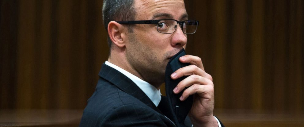 PHOTO: Oscar Pistorius, gestures, as he listens to psychiatric evidence for his defense, during his ongoing murder trial in Pretoria, South Africa, May 13, 2014.