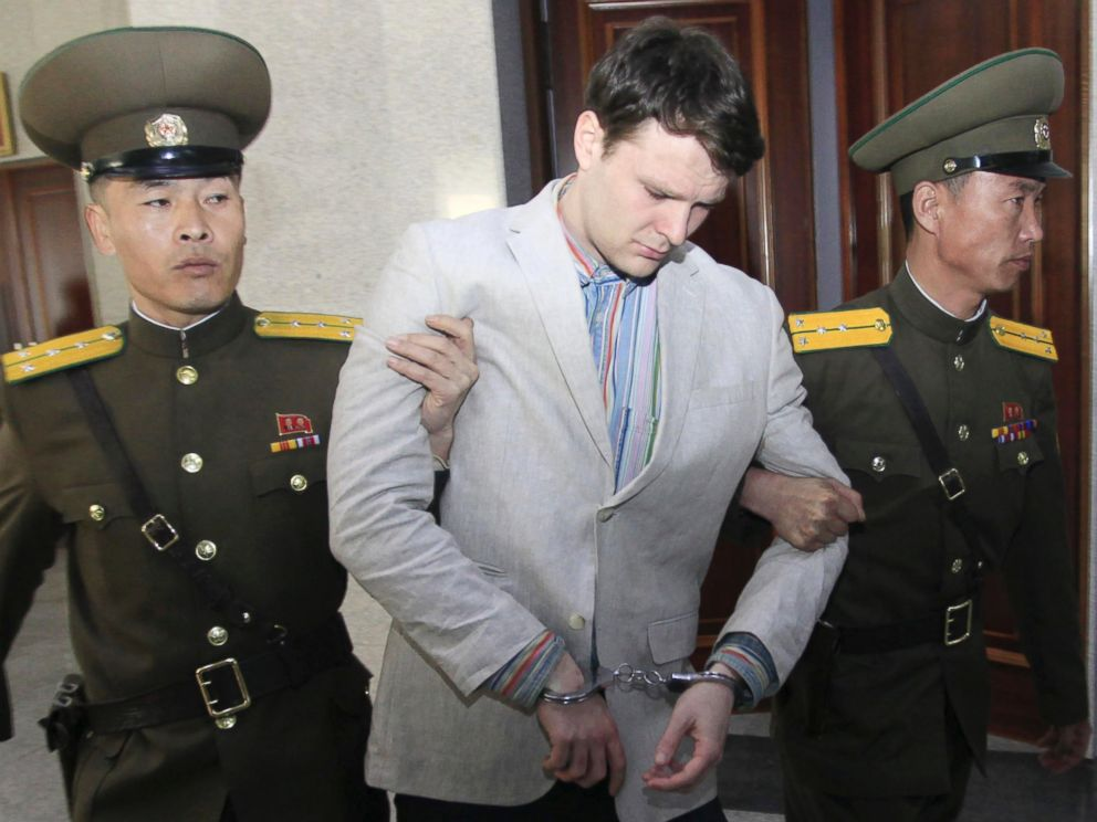 PHOTO: American student Otto Warmbier, center, is escorted at the Supreme Court in Pyongyang, North Korea, March 16, 2016.