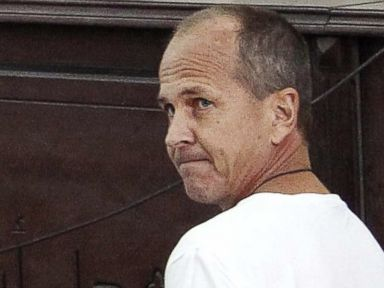 PHOTO: In this Monday, March 31, 2014 file photo, Al-Jazeera English correspondent Peter Greste, appears in court along with several other defendants during their trial on terror charges, in Cairo, Egypt.