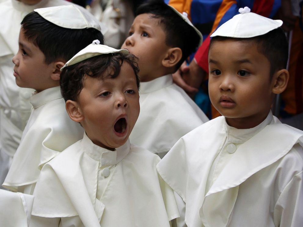 PHOTO: A boy dressed as a Pope, yawns as he prepares to join a parade in celebration of the canonization or the elevation to sainthood in the Vatican of Roman Catholic Pope John Paul II and Pope John XXIII Sunday, April 27, 2014 in the Philippines.