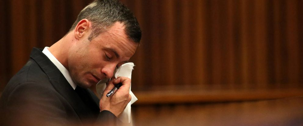 PHOTO: Oscar Pistorius reacts in the dock during cross questioning on mobile phone text messages between him and Reeva Steenkamp in court in Pretoria, South Africa, March 25, 2014.