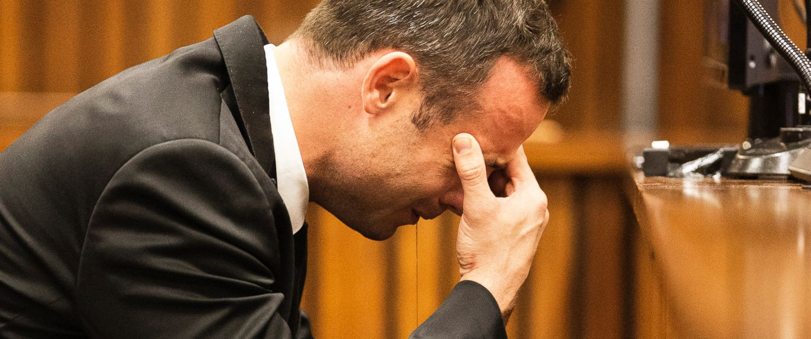 PHOTO: Oscar Pistorius puts his hand to his face while listening to evidence from a witness speaking about the morning of the shooting in court on the fourth day of his trial at the high court in Pretoria, South Africa, March 6, 2014.