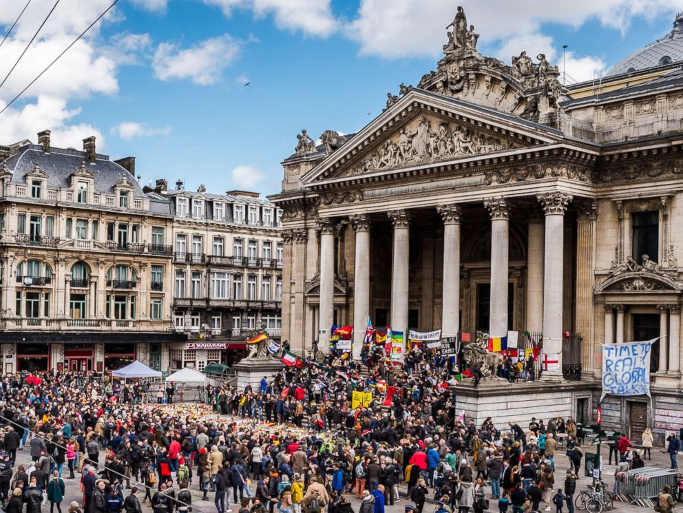 PHOTO: People gather at a memorial site at the Place de la Bourse in Brussels, March 27, 2016.
