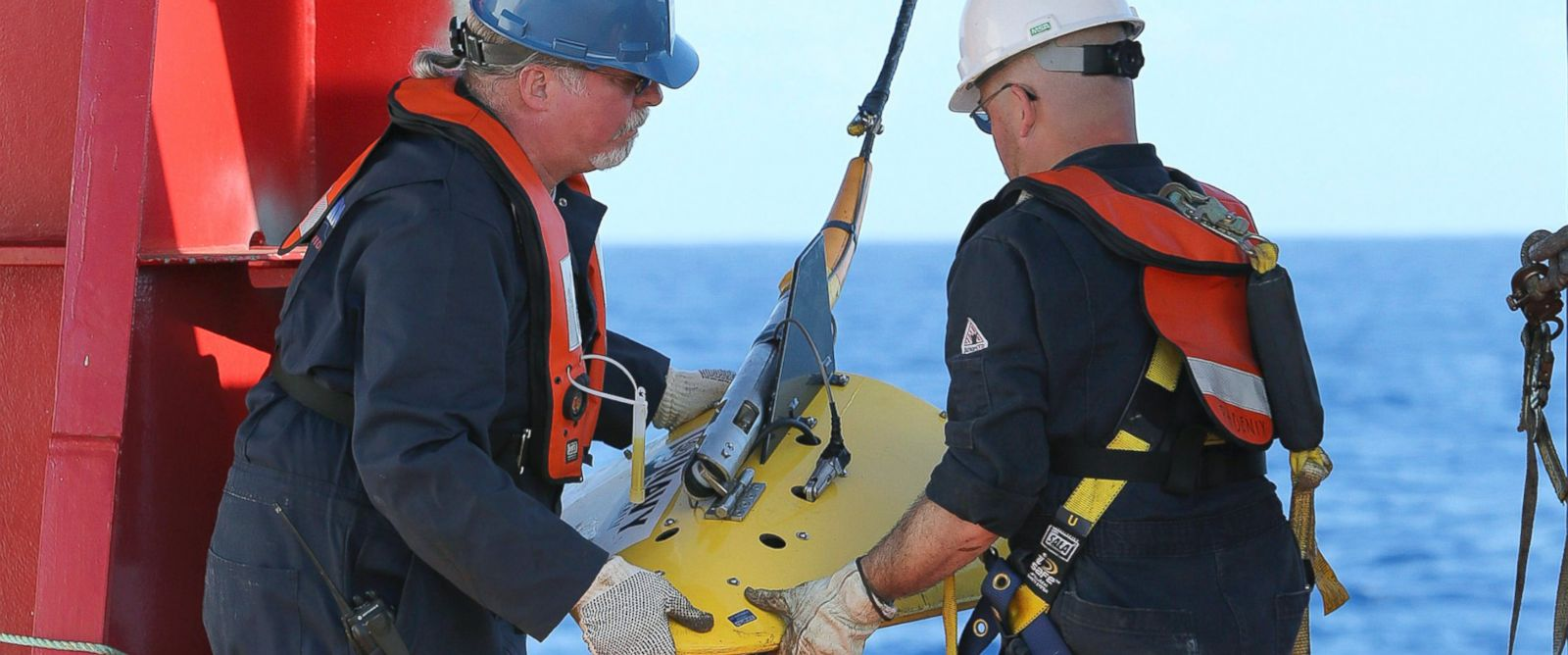 PHOTO: Workers deploy the towed pinger locator off the deck of Australian Defense vessel Ocean Shield in the first search for the missing flight data recorder and cockpit voice recorder in the southern Indian Ocean, April 4, 2014.