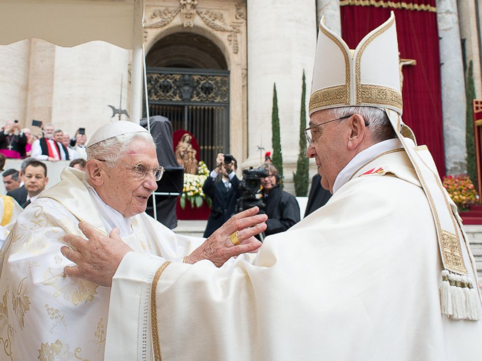 PHOTO: Pope Francis, right, embraces his predecessor Pope Emeritus Benedict XVI, during a ceremony in St. Peters Square at the Vatican, Sunday, April 27, 2014.