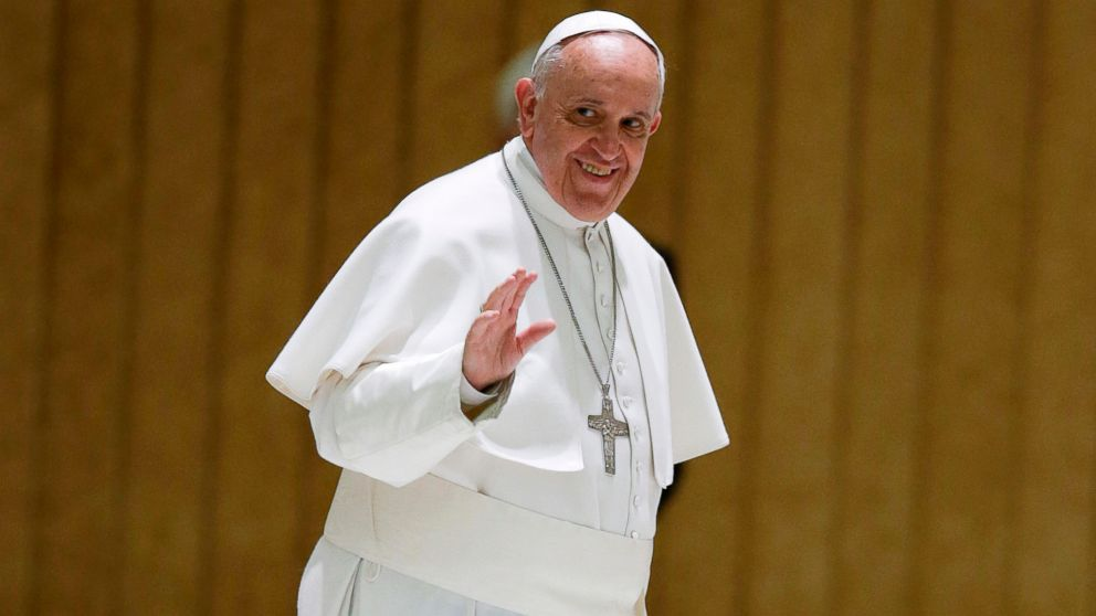 PHOTO: Pope Francis waves to the faithful in the Paul VI hall at the Vatican, March 12, 2015.
