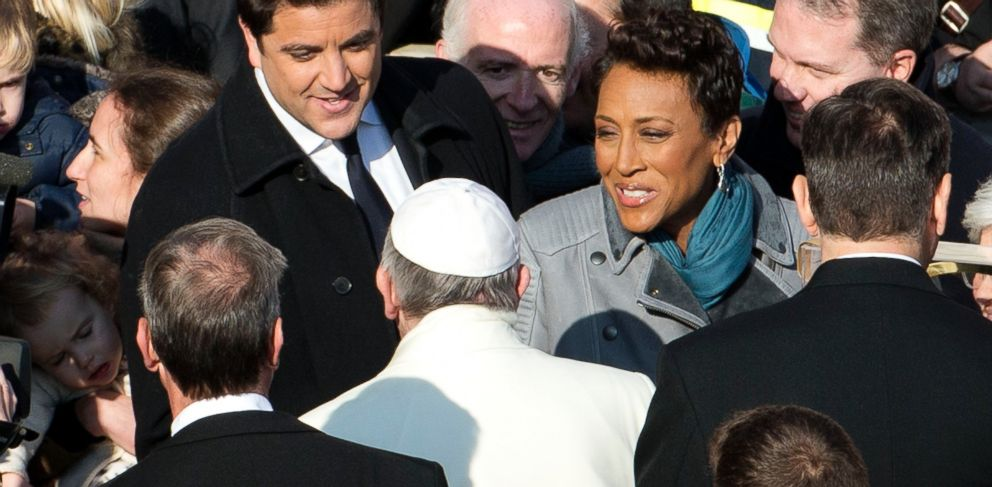 PHOTO: Pope Francis greets Good Morning Americas Josh Elliott and Robin Roberts, Dec. 18, 2013, in Vatican City.
