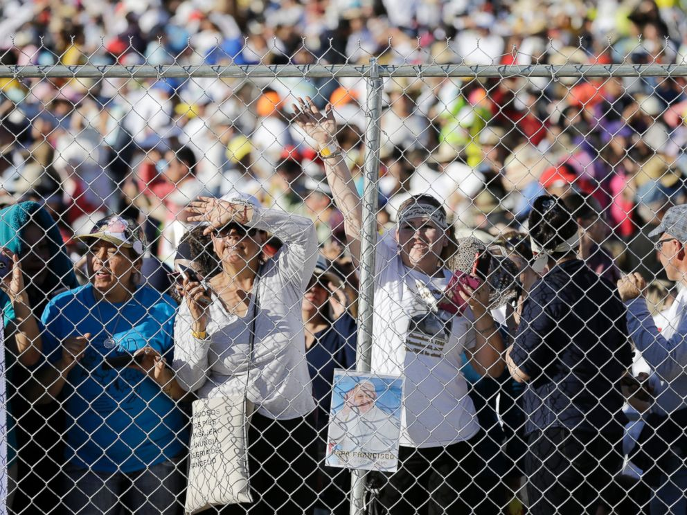PHOTO: People wait to get a glimpse of Pope Francis as he arrives to celebrate an outdoor Mass in Ciudad Juarez, Mexico, Feb. 17, 2016.