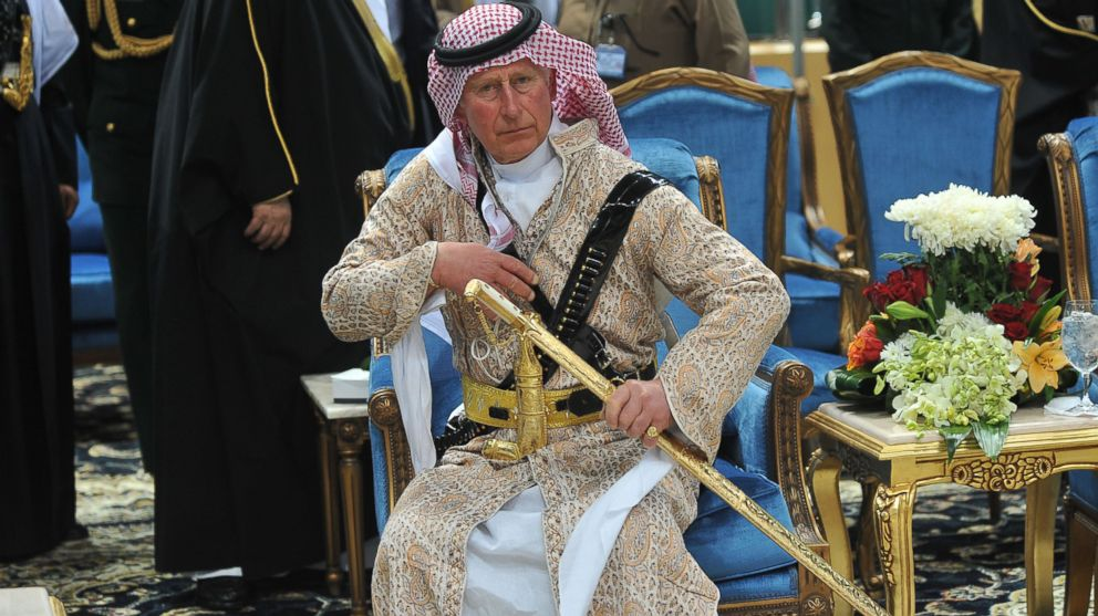 PHOTO: Prince Charles wears traditional Saudi uniform as he attends the Arda performance in Riyadh, Saudi Arabia, Feb. 18, 2014.