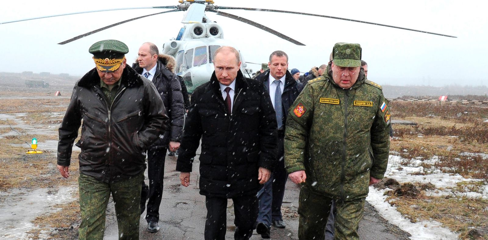 PHOTO: Russian President Vladimir Putin, center, Defense Minister Sergei Shoigu, left, and the commander of the Western Military District Anatoly Sidorov, right, walk upon arrival to watch military exercise near St.Petersburg, Russia, March 3, 2014.