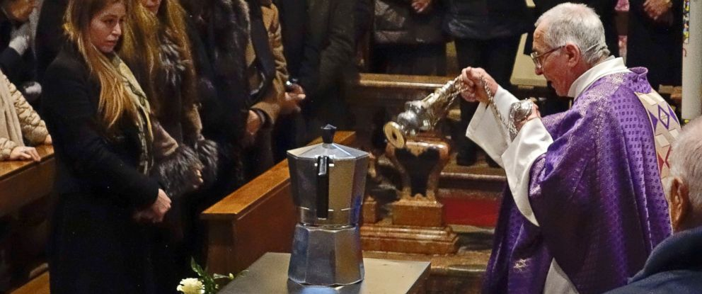 PHOTO: Father Pietro Segato, the parish priest of Casale Corte Cerro, asperses incense on a Moka pot containing the ashes of Renato Bialetti, during his burial service in the church of Casale Corte Cerro, Northern Italy, Feb. 16, 2016.