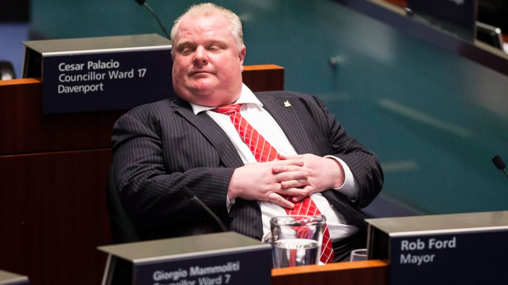 PHOTO: Toronto Mayor Rob Ford sits in the council chamber as Councillors look to pass motions to limit his powers, Nov. 18, 2013, in Toronto.