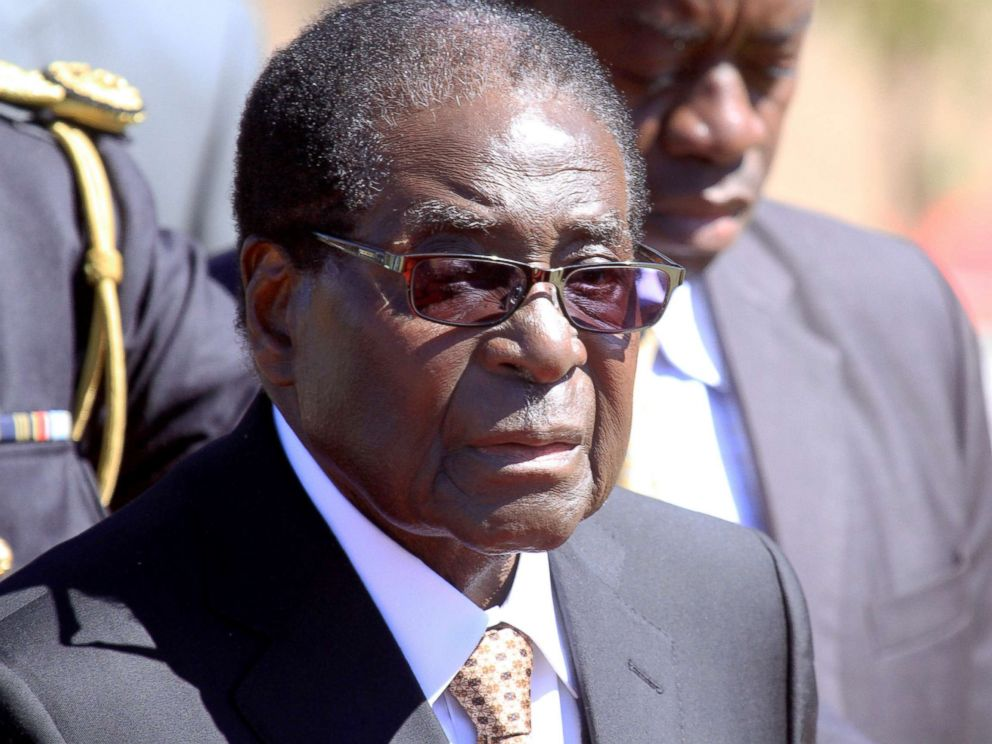 PHOTO: Zimbabwean President, Robert Mugabe, attends the burial of Major General Bandama who died after a short illness at the National Heroes acre in Harare, Zimbabwe, July, 17, 2014.