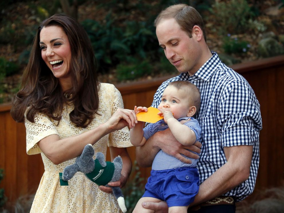 PHOTO: Britains Kate, the Duchess of Cambridge, and her husband Prince William react as their son Prince George bites a small present that was given to him during a visit to Sydneys Taronga Zoo, Australia Sunday, April 20, 2014.