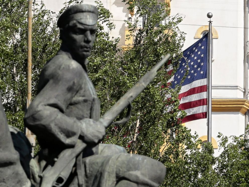 PHOTO: A monument to Russian revolutionary workers with the U.S. flag and the U.S. Embassy in the background seen in downtown Moscow, Russia.