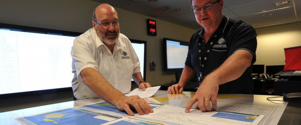 PHOTO: Mike Barton, rescue coordination chief, left, looks over the maps of the Indian Ocean with Alan Lloyd, manager of search and rescue operations at the Australian Maritime Safety Authoritys rescue coordination center in Canberra, March 23. 2014.