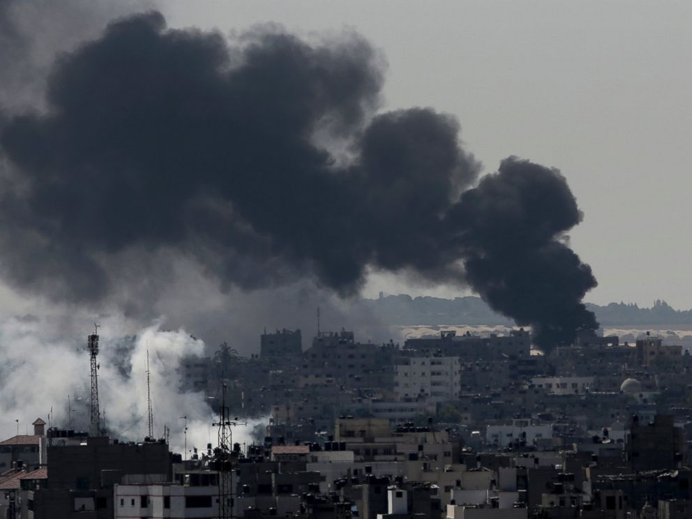 PHOTO: Smoke from Israeli strikes rises over Gaza City, in the northern Gaza Strip, Sunday, July 27, 2014. Israel resumed its Gaza offensive on Sunday, calling off a unilateral extension of a cease-fire after Palestinian militants fired rockets at Israel.