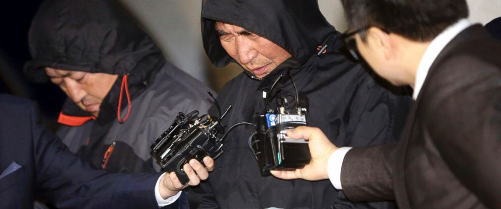 PHOTO: Lee Joon-seok, center, the captain of the sunken ferry Sewol in the water off the southern coast, talks to the media before leaving a court which issued his arrest warrant in Mokpo, south of Seoul, South Korea, April 19, 2014.