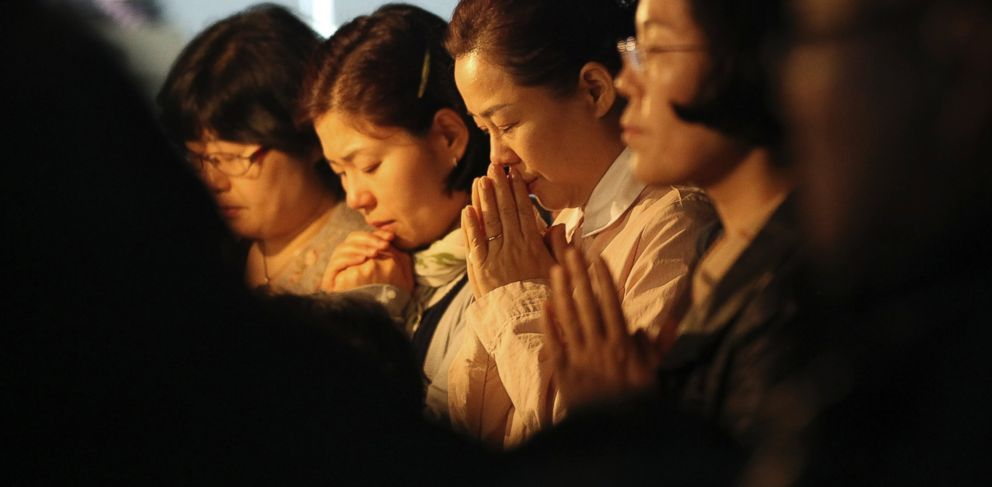 PHOTO: Relatives of missing passengers aboard the sunken ferry Sewol pray to wish for safe return of their family members during an annual Easter service in Jindo, South Korea, Sunday, April 20, 2014.