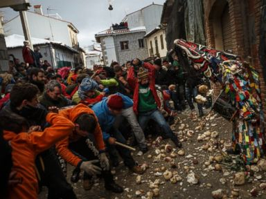 PHOTO: People throw turnips at the Jarramplas as he makes his way through the streets