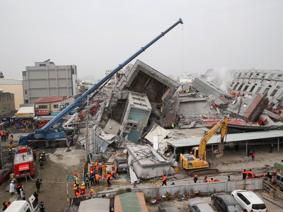 PHOTO: Rescue workers search a collapsed building from an early morning earthquake in Tainan, Taiwan, Feb. 6, 2016.