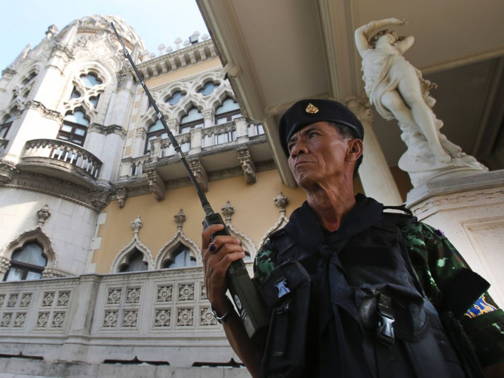 PHOTO: A Thai soldier guards outside Government House compound of prime ministers office,in Bangkok, Thailand, Tuesday, May 20, 2014.