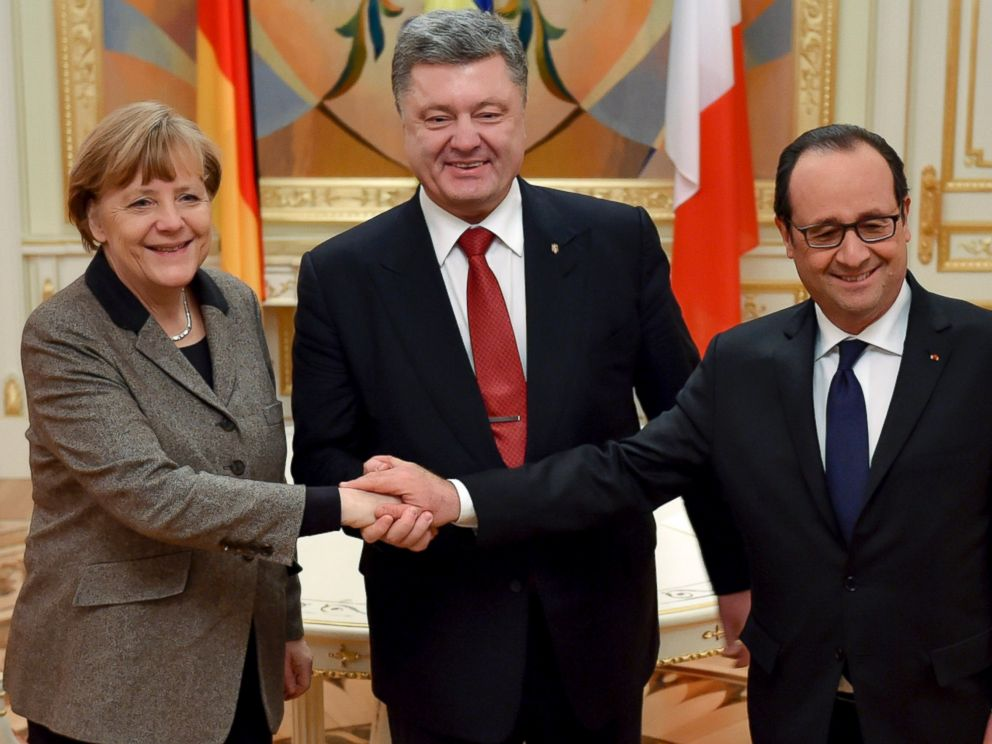 PHOTO: Ukrainian President Petro Poroshenko, center, French President Francois Hollande, right, and German Chancellor Angela Merkel shake hands during their meeting in Kiev, Ukraine, Feb. 5, 2015.