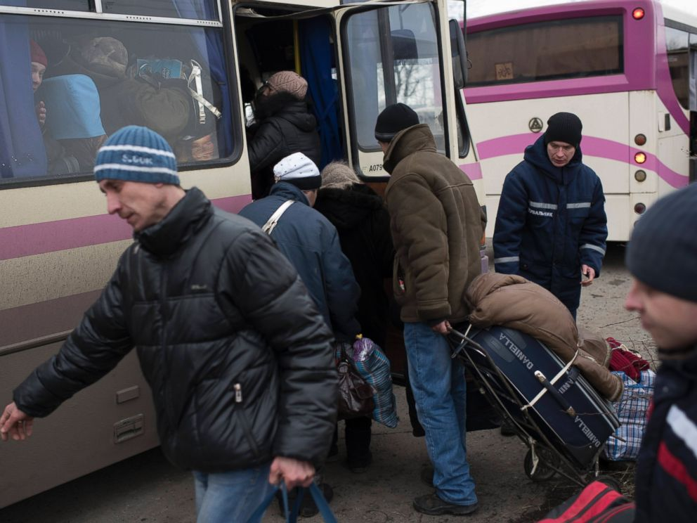 PHOTO: Civilians board a bus near Artemivsk, eastern Ukraine, Feb. 5, 2015, as people are evacuated from Debaltseve.