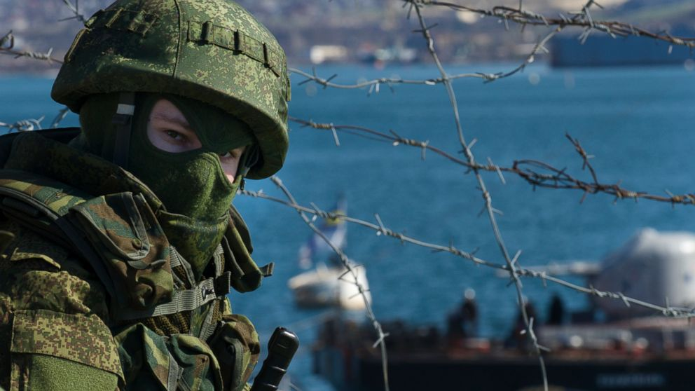 PHOTO: Russian soldiers guard a pier where two Ukrainian naval ships are moored, in Sevastopol, Ukraine, March 5, 2014.