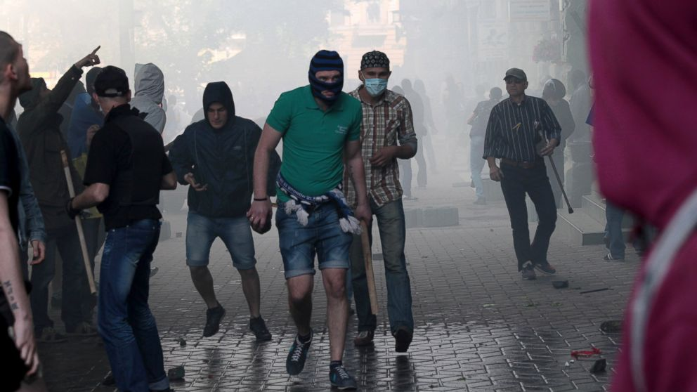 PHOTO: A Ukrainian government supporter holds a stone and a stick during a clash with pro-Russians in the Black Sea port of Odessa, Ukraine, May 2, 2014.