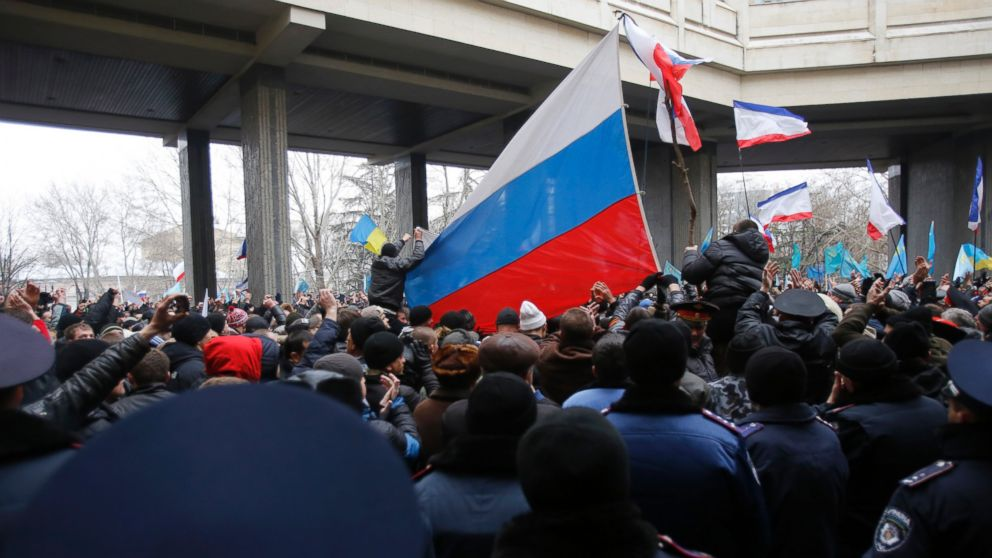PHOTO: Pro-Russian demonstrators wave Russian flags during a protest in front of a local government building in Simferopol, Crimea, Ukraine on Feb. 26, 2014.