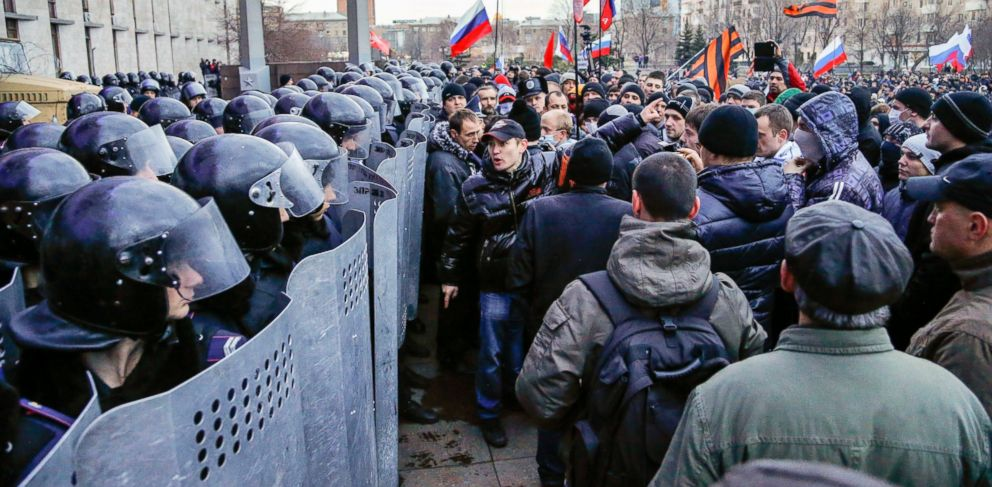 PHOTO: Pro-Russia demonstrators face Ukrainian police officers surrounding the Donetsk regional administration building during a rally in Donetsk, Ukraine, Sunday, March 16, 2014.