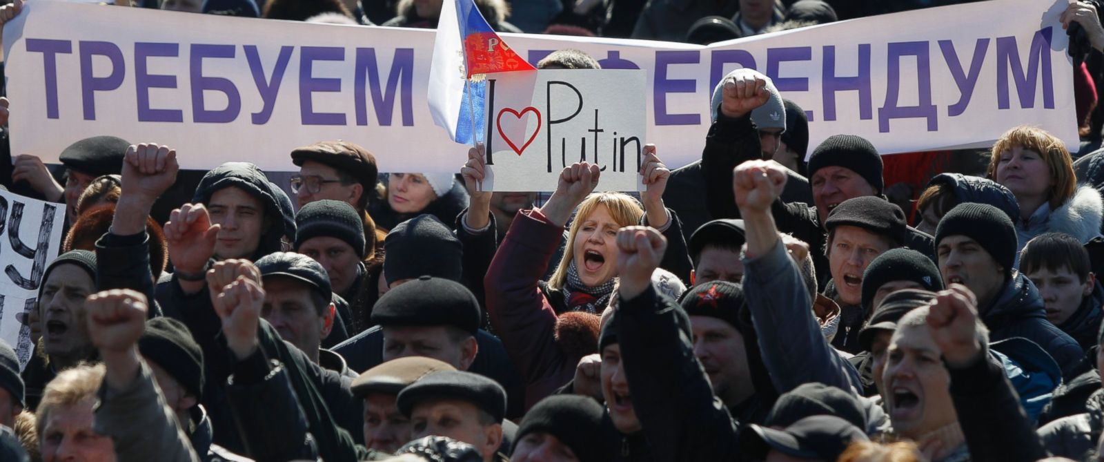 "PHOTO: People hold a banner reading, ""We demand a referendum"" as they shout slogans during a pro Russian rally in Donetsk, Ukraine, Saturday, March 8, 2014."
