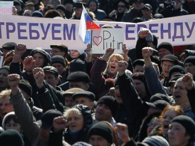 PHOTO: People hold a banner reading, We demand a referendum as they shout slogans during a pro Russian rally in Donetsk, Ukraine, Saturday, March 8, 2014.